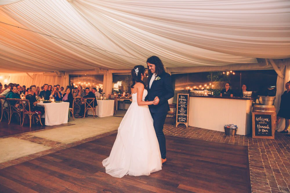 Outdoor Wedding Dance under white draped ceiling