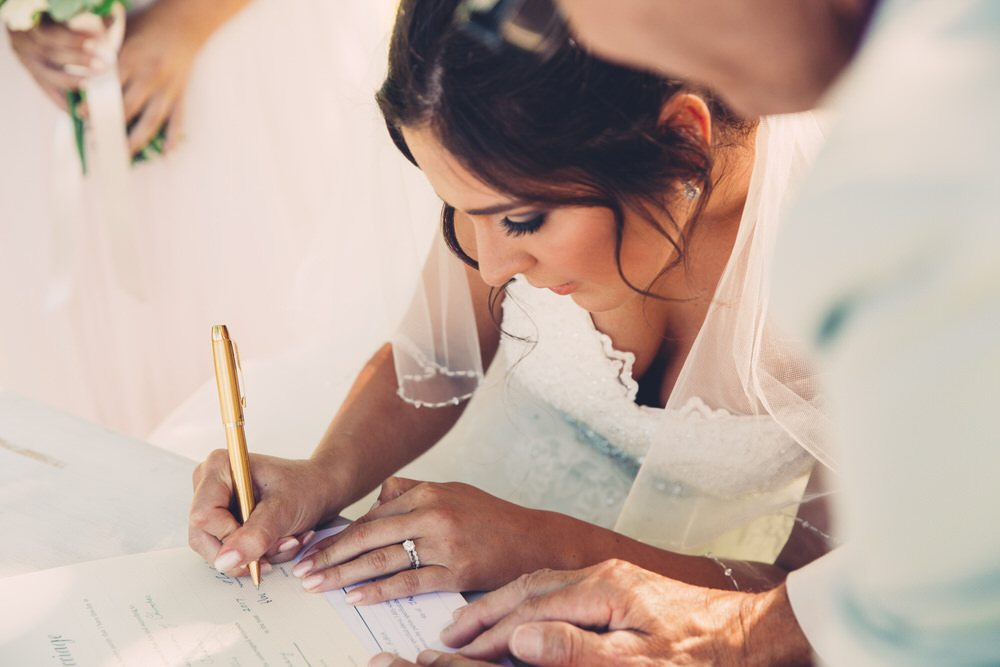 bride signs legal documents