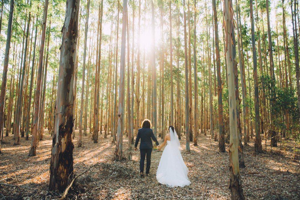 bride and groom walking in the Australian bush