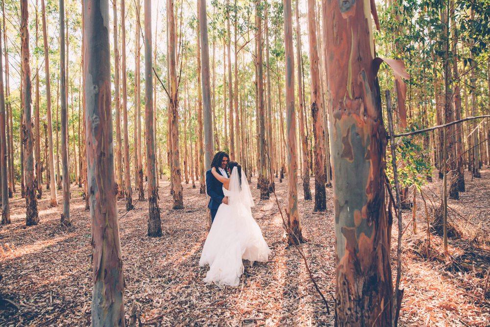 bride and groom hug in the bush