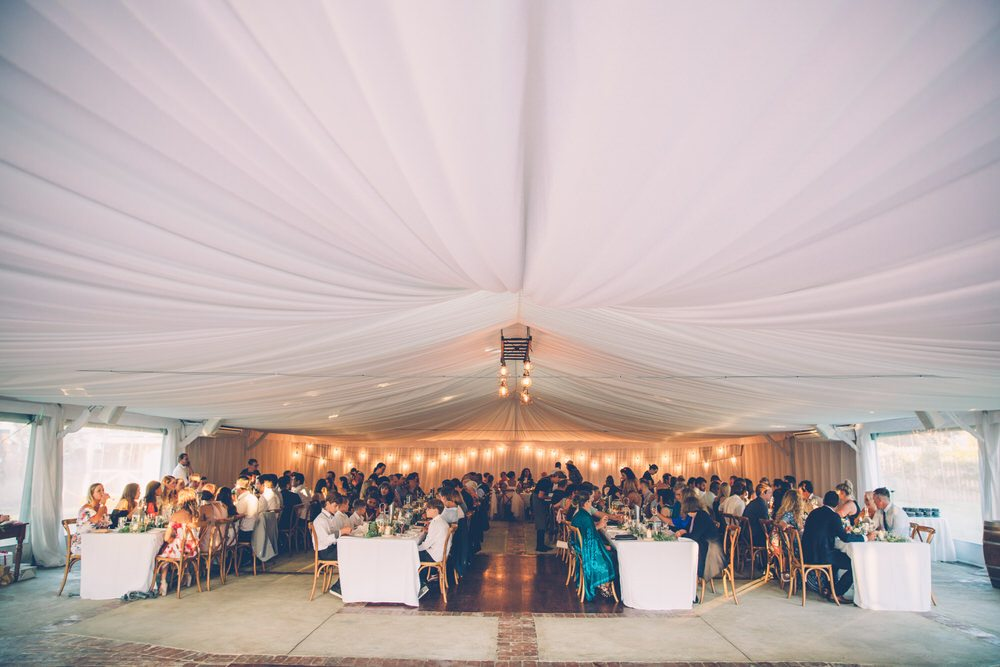 Beautiful white draping ceiling at wedding reception venue