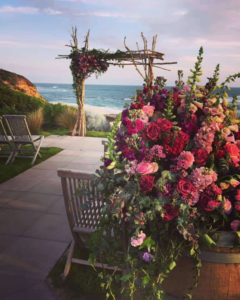 Beach floral ceremony set up