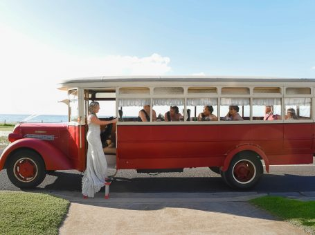 Wedding bus with bride and bridesmaids