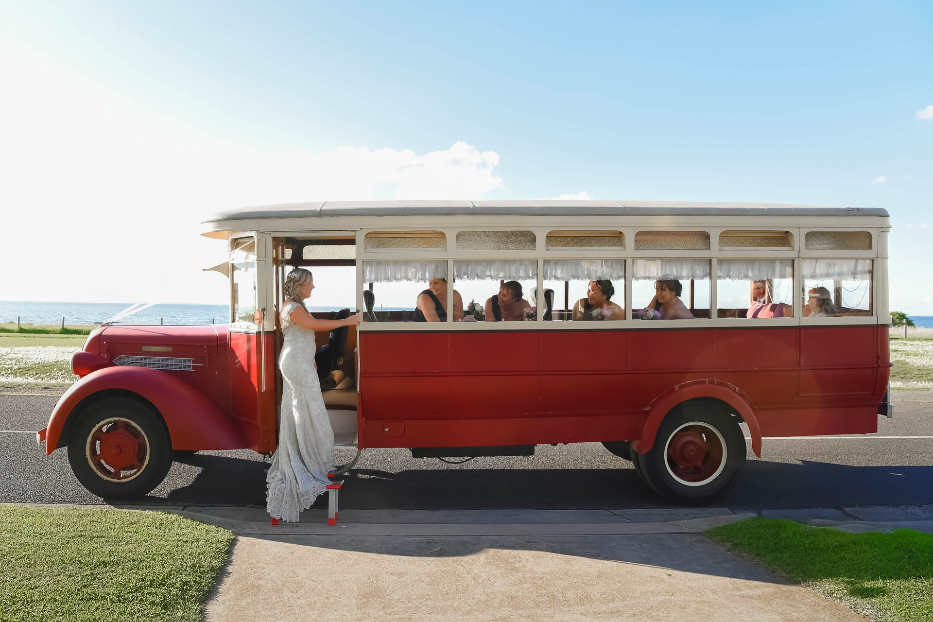 Wedding bus with bride and bridesmaids