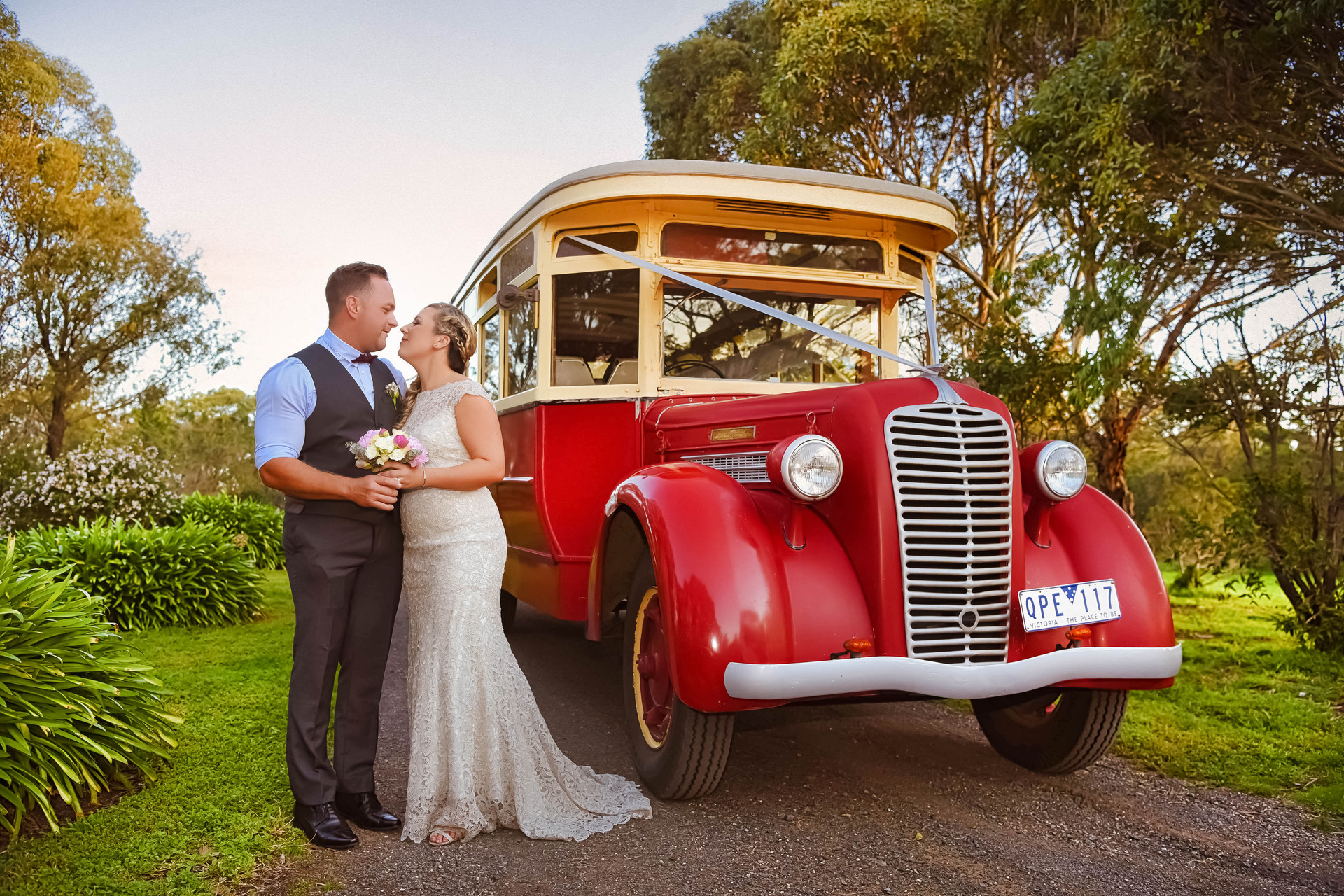 bride and groom with wedding bus
