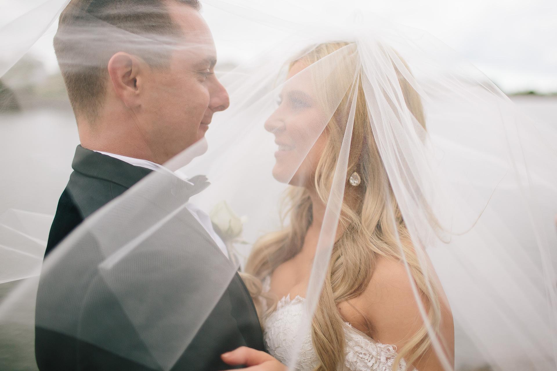 bride in veil with groom